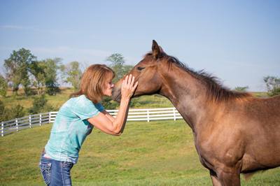 Susan Knapp with foals